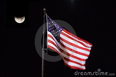 American Flag blowing in the night sky