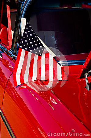 American flag on a classic car