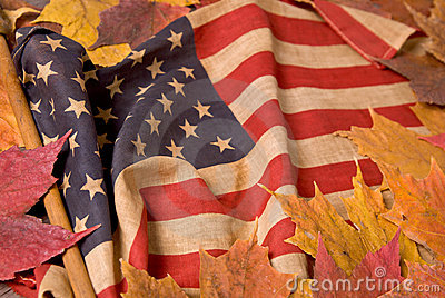 American flag with fall leaves