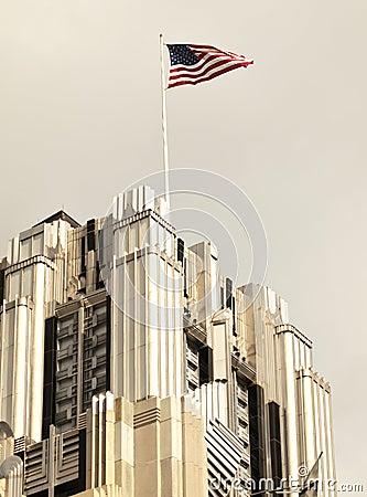 American flag on skyscraper