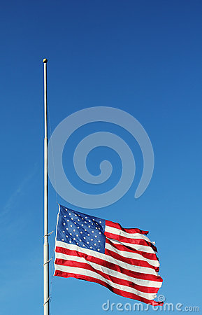 American flag flying at half staff in memory of Newtown massacre victims .