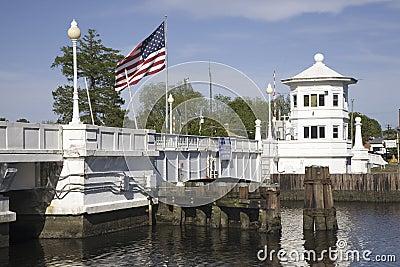 American Flag flying over white bridge Editorial Stock Image