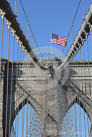 American flag on top of famous Brooklyn Bridge