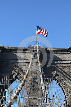 American flag on top of famous Brooklyn Bridge