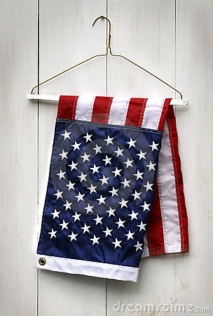 American flag folded with clothes hanger