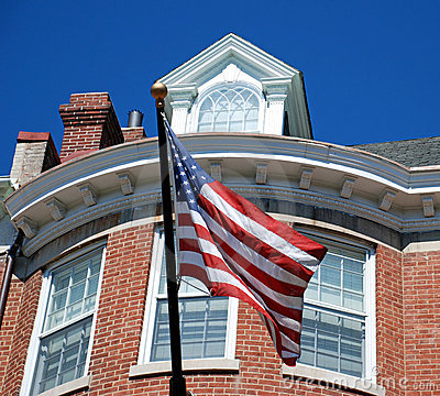 American Flag in Front of Brick Home