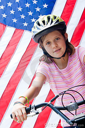 American flag and girl on bike