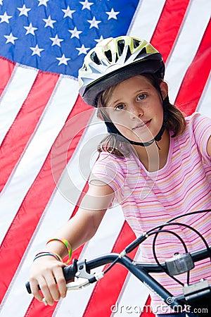 American flag and girl on bike