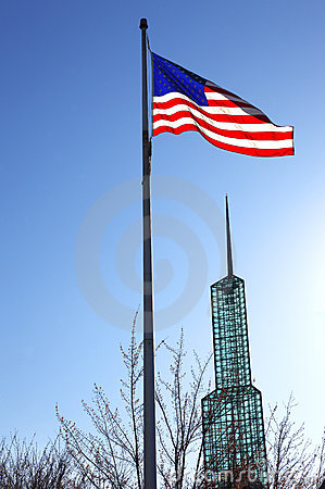 American flag & glass tower.