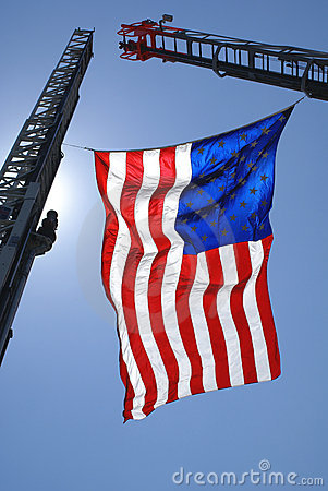 American Flag Hanging on Cranes