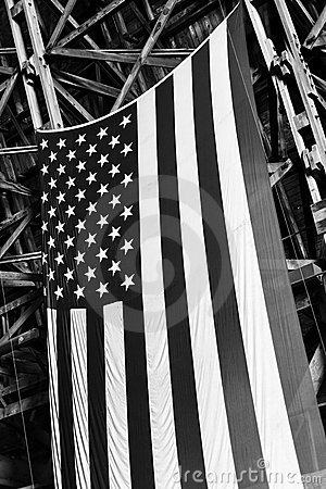American flag hanging in an old blimp hanger