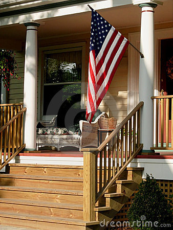 American flag on porch.