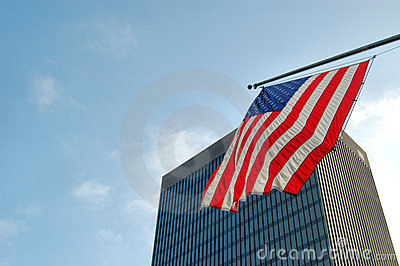 American flag and skyscraper