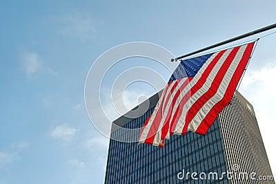 American flag and skyscraper