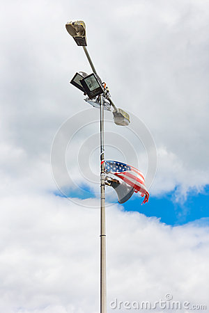 American flag tied to an old lamp post