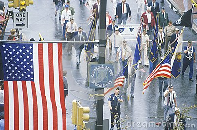 American Flag and Veterans Marching Editorial Stock Image