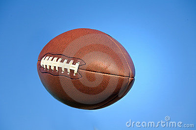 American football in blue sky with clipping path.