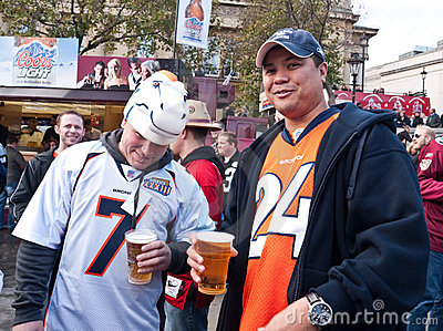 American Football Fans Enjoy a Pint at Fan Rally. Editorial Stock Photo
