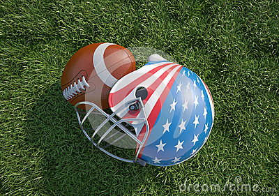 American football helmet decorated as US flag and ball, on the grass.