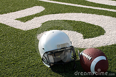 American Football and Helmet on Field