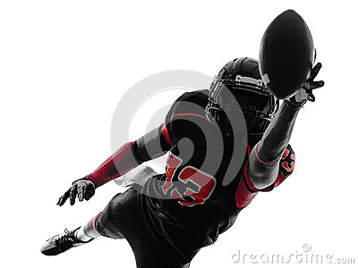 American football player catching ball  silhouette
