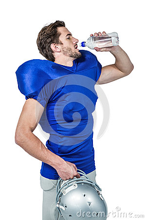 Free American Football Player Holding Helmet While Drinking Water Stock Image - 60531701