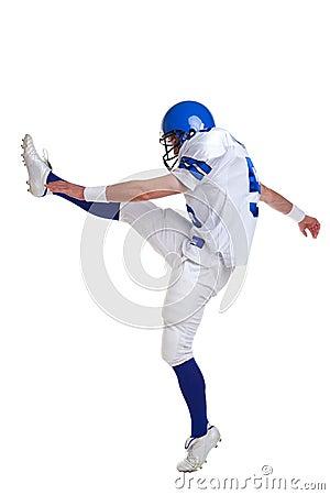 American football player kicking