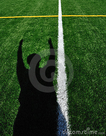 American Football Referee Signaling Touchdown