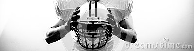American Football runningback quarterback take a helmet