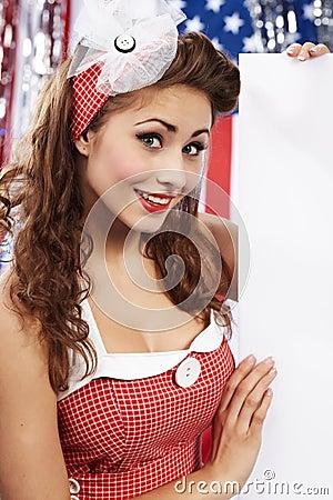 American girl holding blank board