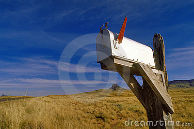 American mailbox with red flag