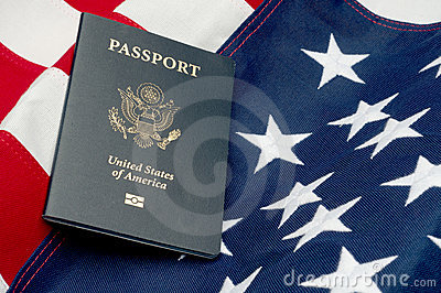 An American passport on an American flag