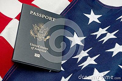 An American passport on an American flag