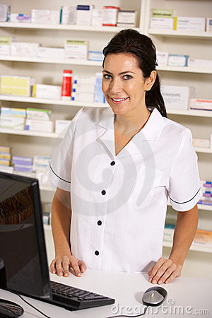 American pharmacist using computer in pharmacy