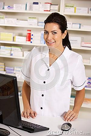 American pharmacist using computer in pharmacy