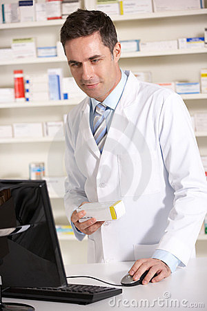 American pharmacist working on computer