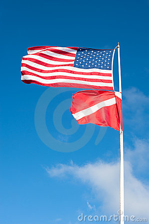 American and scuba flag blowing