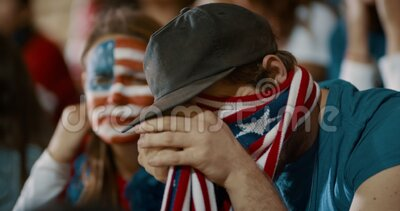 American soccer fans watching game nervously from stands. American fans looking nervous while watching soccer match from stands. Group of anxious looking stock video footage