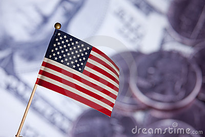 American toy flag over US dollars banknotes.