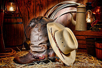 American West Rodeo Cowboy Hat and Boots in a Barn