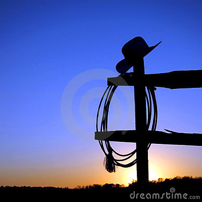 American West Rodeo Cowboy Hat And Lasso On Fence Royalty