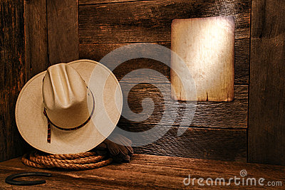 American West Rodeo Cowboy Hat and Rope in Barn