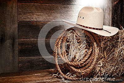 American West Rodeo Cowboy Straw Hat on Hay Bale