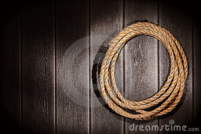 American West Rodeo Rope on Old Rustic Barn Wall