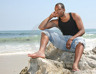 American Youth in Deep Thought on the Beach