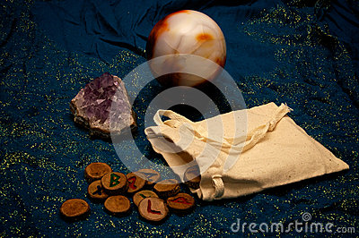 Amethyst and crystal ball with runes