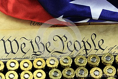 Ammunition and flag on US Constitution - History of the Second Amendment