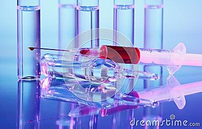 Ampoule and syringe macro still life