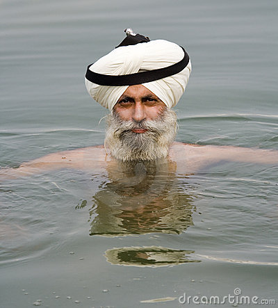 Amritsar - Sikh man bathing in sacred pool Editorial Stock Image