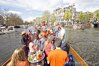 AMSTERDAM - APRIL 30: Amsterdam canals full of boats and people Editorial Stock Image